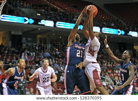 PHILADELPHIA - FEBRUARY 14: Duquesne Dukes forward Quevyn Winters (21) blocks a shoot by Khalif Wyatt during an Atlantic 10 conference basketball game February 14, 2013 in Philadelphia