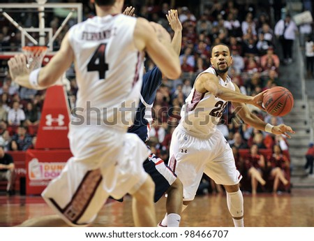 PHILADELPHIA - FEBRUARY 18: Temple Owls guard Aaron Brown (#22) passes the ball during the NCAA basketball game between Duquesne and Temple February 18, 2012 in Philadelphia.