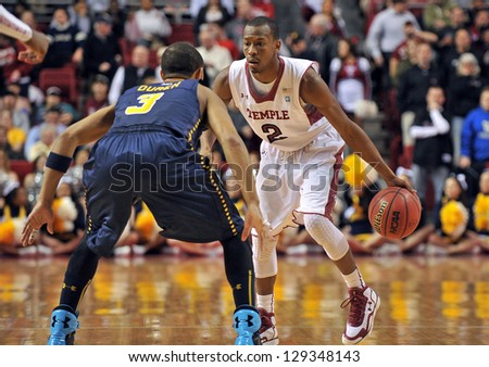 PHILADELPHIA - FEBRUARY 21: Temple Owls guard Will Cummings (2) dribbles as La Salle Explorers guard Tyreek Duren (3) defends during the A-10 basketball game February 21, 2013 in Philadelphia.