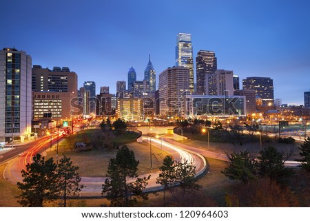 Philadelphia. Image of Philadelphia skyline and busy roads during twilight blue hour.