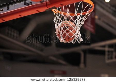 PHILADELPHIA - JANUARY 19: A basketball falls through the net for a basket during the Atlantic 10 basketball conference game against St. Bonaventure January 19, 2013 in Philadelphia.