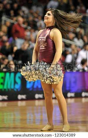 PHILADELPHIA - JANUARY 18: A member of the Temple Diamond Gems dance team performs during a basketball game against LaSalle January 18, 2012 in Philadelphia.