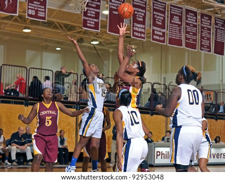 PHILADELPHIA - JANUARY 14: Central High School's Melissa Livingston (#21) releases a shot as Christina Coleman (#15) defends during the Rally Girls Play by Play Classic January 14 2012 in Philadelphia