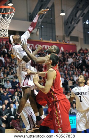 PHILADELPHIA - JANUARY 21:Temple forward Anthony Lee (headband) tries for a block during the Temple vs. Maryland NCAA college basketball game January 21, 2012 in Philadelphia.