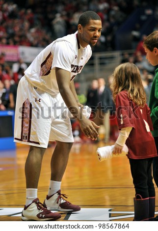 PHILADELPHIA - JANUARY 21: Temple guard Khalif Wyatt (#1) greets a young fan prior to the start of the Temple vs. Maryland NCAA college basketball game January 21, 2012 in Philadelphia.