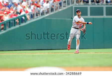 PHILADELPHIA - JULY 26: St. Louis Cardinals shortstop Julio Lugo throws to first during the July 26, 2009 game in Philadelphia.