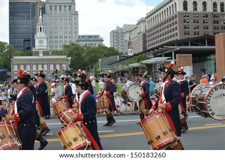 PHILADELPHIA- JULY 4:The Mattatuck Drum Band marches in the Independence Day Parade as it makes its way along Market St. on July 4, 2013 in Philadelphia, PA.