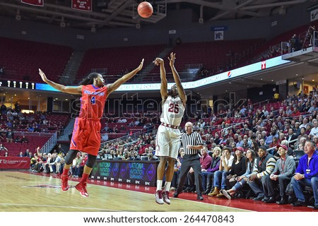PHILADELPHIA - MARCH 25: Temple Owls guard Quenton DeCosey (25) takes a three point shot during the NIT quarterfinal basketball game March 25, 2015 in Philadelphia.