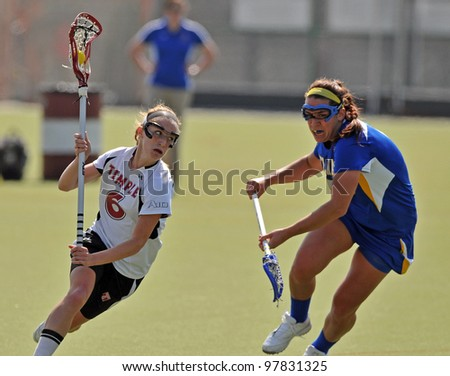 PHILADELPHIA - MARCH 17: Temple women's lacrosse player Charlotte Swavola (#6) tries to avoid a check by Delaware's Alex Alois (#9) during a game against Delaware March 17, 2012 in Philadelphia