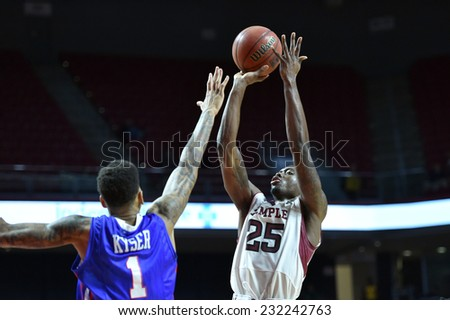PHILADELPHIA - NOVEMBER 17: Temple Owls guard Quenton DeCosey (25) launches up a three point shot during the NCAA basketball game November 17, 2014 in Philadelphia.