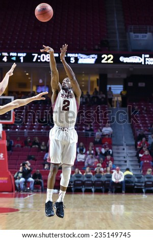PHILADELPHIA - NOVEMBER 30: Temple Owls guard Will Cummings (2) launches a three-point shot during the NCAA basketball game November 30, 2014 in Philadelphia.