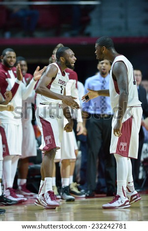 PHILADELPHIA - NOVEMBER 17: Temple teammates Josh Brown (1) and Mark Williams (10) celebrate a possible three point play during the NCAA basketball game November 17, 2014 in Philadelphia.