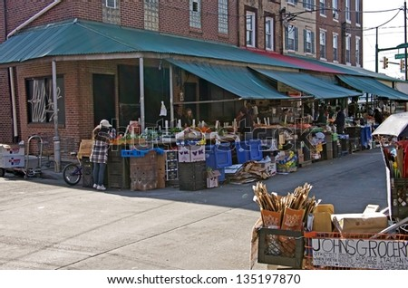 PHILADELPHIA, PA-APRIL 5:   Busy shoppers pick out the best fruits and vegetables at Philadelphia�s Italian Market on April 5, 2013. It is the oldest and largest working outdoor market in the US.