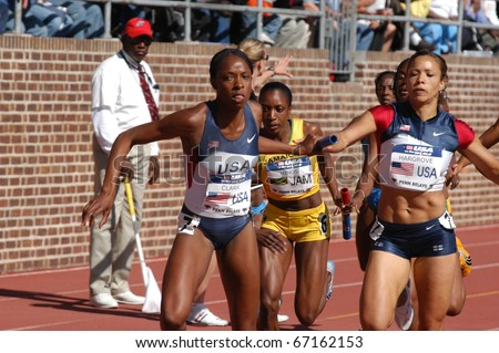 PHILADELPHIA, PA - APRIL 29: Hazel Clark takes handoff from Monica Hargrove on April 29, 2006 in Philadelphia.  They are on the 800-meter anchor of the USA Blue women's sprint medley relay  in the 112th Penn Relay