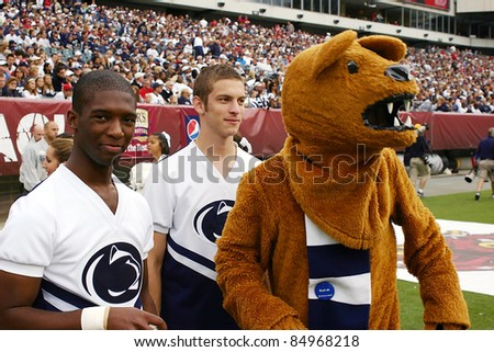 PHILADELPHIA, PA. - SEPTEMBER 17: Penn State cheerleaders on the sidelines with the Nittany Lion during a game against Temple on September 17, 2011 at Lincoln Financial Field in Philadelphia, PA.