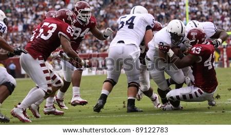 PHILADELPHIA, PA. - SEPTEMBER 17: Penn State runningback Brandon Beachum runs off tackle  during a game against Temple on September 17, 2011 at Lincoln Financial Field in Philadelphia, PA. - stock photo