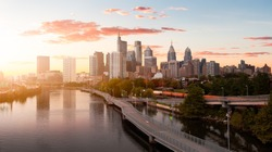 Philadelphia, Pennsylvania, United States of America. Aerial Panoramic View of a Modern Downtown City. Sunset Sky Composite. Cityscape Panorama