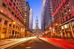 Philadelphia, Pennsylvania, USA downtown at city hall during evening rush hour.