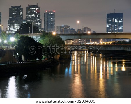 Philadelphia river, bridges and towers reflecting at night.