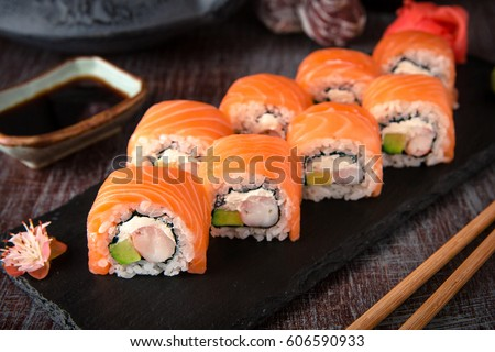 Philadelphia roll sushi with salmon, prawn, avocado, cream cheese. Sushi menu. Japanese food.