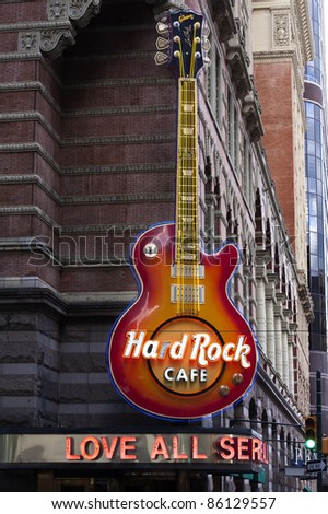 PHILADELPHIA - SEPTEMBER 19: Hard Rock Cafe guitar signage on Sept. 19, 2011 in Philadelphia, PA location. The Hard Rock Cafe has been collecting guitars since Eric Clapton donated his in 1979