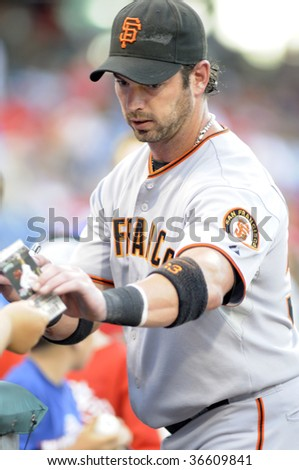 PHILADELPHIA - SEPTEMBER 2: San Francisco Giants outfielder Aaron Rowand reached for a ticket stub to autograph prior to the September 2, 2009 game in Philadelphia.