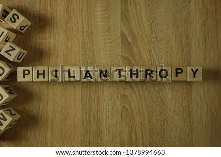 Philanthropy word from wooden blocks on desk
