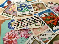 Philately: Spring themed stamp collection.