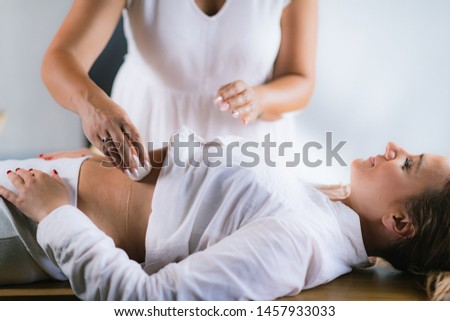 Philippine Psychic Surgery Healer Preparing for Treatment. Using Cotton Ball and Water.