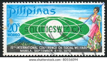 PHILIPPINES - CIRCA 1970: stamp printed by Philippines, shows Emblem, Mayon Volcano and Filipina, circa 1970