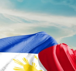 Philippines waving flag in the sky.