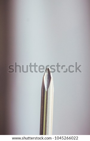 Phillips screwdriver with a black handle. tools for home. men's tools. macro photo. photo close-up. screwdriver on a gradient background