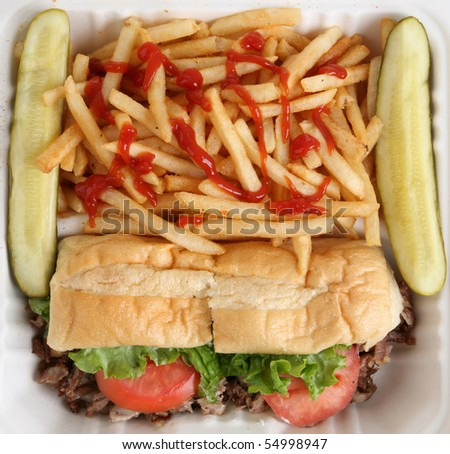 Philly Cheese Steak Sandwich with Fries and Pickles