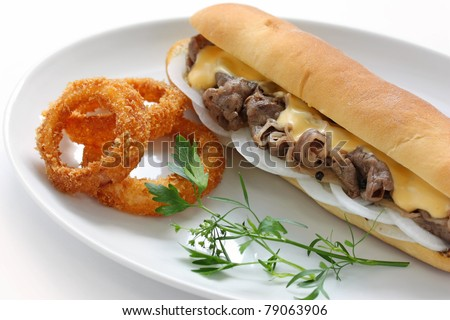 philly cheese steak sandwich with onion rings