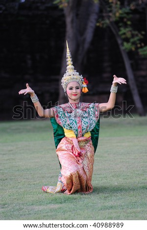 stock photo : PHIMAI, THAILAND - NOVEMBER 14: A Thai dancer performs Thai dance in the occasion of Phimai Light and Sound Festival at Phimai Stone Castle November 14, 2009 in Phimai, Thailand.