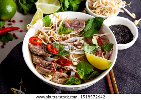 Pho Bo - Vietnamese fresh rice noodle soup with beef, herbs and chili. Vietnam's national dish. Top view Stok fotoğraf ©