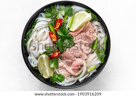 Pho Bo vietnamese soup with beef and rice noodles on a white background, top view, close-up Stok fotoğraf ©