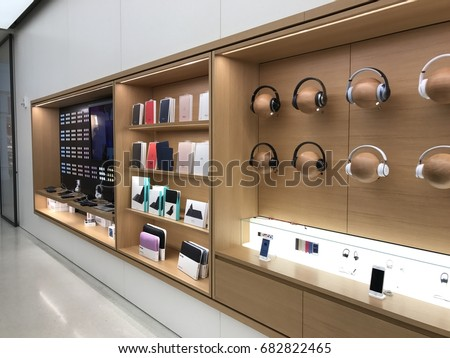 PHOENIX - APRIL 19: Beats by Dre headphones, Air-pods, and other accessories displayed for sale at the renovated Apple Store at Arrowhead shopping mall in Phoenix, Arizona USA on April 19, 2017.