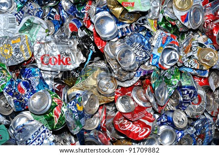 PHOENIX, AZ - APRIL 29: Crushed soda and beer cans at a recycling facility in Phoenix AZ on April 29, 2009. The cans will be shipped to an aluminum foundry.