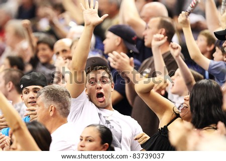 PHOENIX, AZ - APRIL 2: Excited Arizona Rattlers fans cheer during Arena Football League action against the Orlando Predators at U.S. Airways Center on April 2, 2011 in Phoenix AZ.