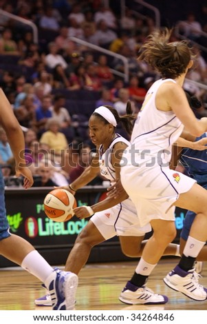 PHOENIX, AZ - JULY 22: Temeka Johnson (2) of the WNBA Phoenix Mercury tries to penetrate the defense of the Minnesota Lynx during Wednesday nights game on July 22, 2009.