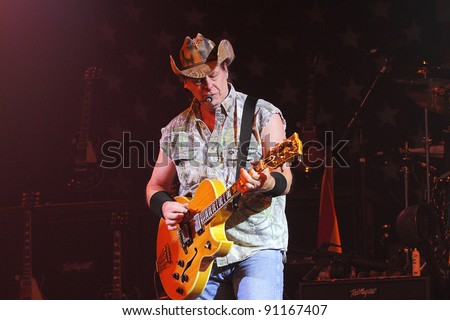 "PHOENIX, AZ - JUNE 28: Ted Nugent, ""The Motor City Madman"" performs for fans at the Celebrity Theatre in Phoenix, Arizona on June 28, 2011."