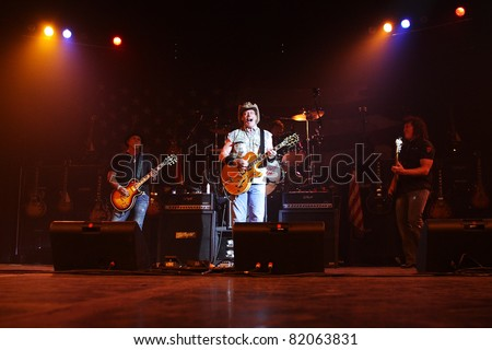 PHOENIX, AZ - JUNE 28: The Ted Nugent band, Derek St. Holmes (left) Ted Nugent (center) and Greg Smith (right) performs for fans at the Celebrity Theatre in Phoenix Arizona on June 28, 2011.