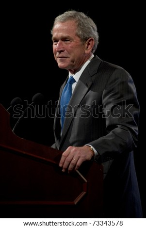 PHOENIX, AZ - MARCH 16: Former President George W. Bush smiles as he speaks at the Phoenix Convention Center on  March 16, 2011 in Phoenix, AZ.
