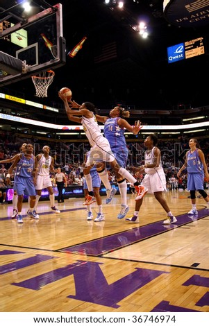 PHOENIX, AZ - SEPTEMBER 5: DeWanna Bonner (24) of the WNBA Phoenix Mercury drives for a shot under the basket during Saturday nights game against the Atlanta Dream on September 5, 2009 in Phoenix.