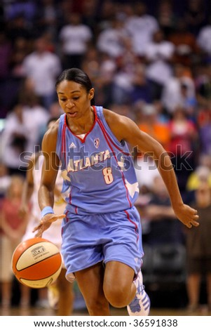 http://image.shutterstock.com/display_pic_with_logo/223840/223840,1252256809,3/stock-photo-phoenix-az-september-iziane-castro-marques-of-the-wnba-atlanta-dream-drives-the-ball-down-36591838.jpg
