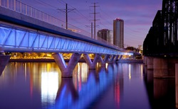 Phoenix Metro light rail bridge across the Salt River in Tempe Arizona photographed at sunset.
