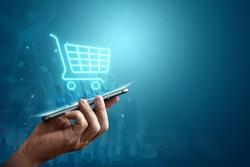 Phone and basket hologram. Online shopping, online store application in a smartphone. Digital Marketing Online