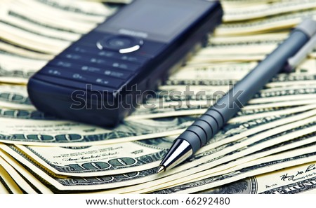 phone and pen on the money background