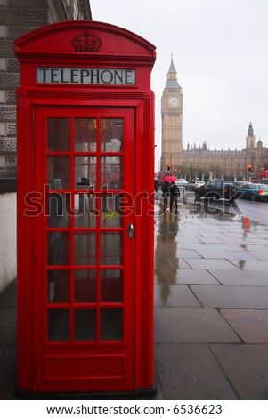 Phone box and Big Ben on a rainy day, London England